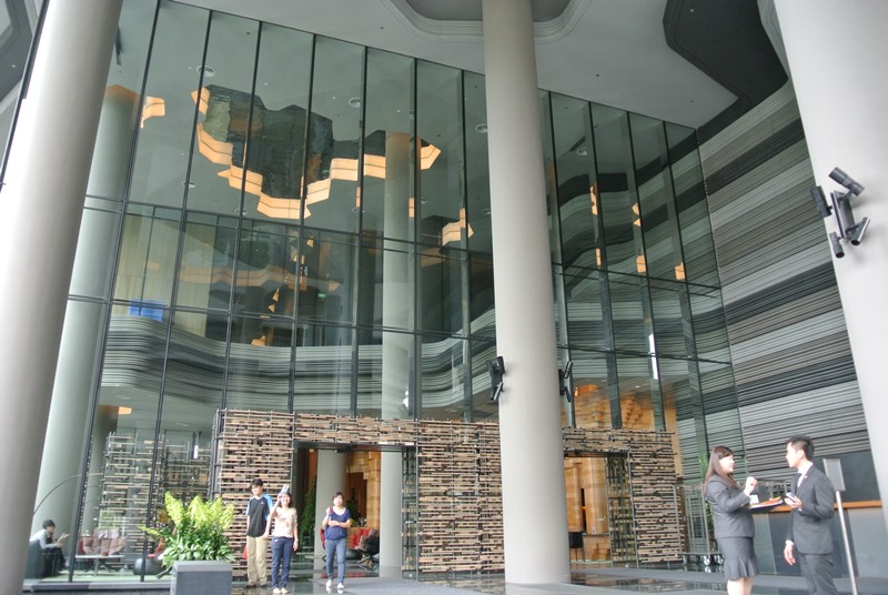 - 13m high low-iron glass shopfront with S.S fins in mirror finish.